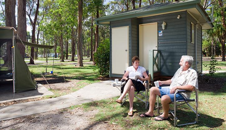 Coffs harbour pet friendly caravan park nsw couple siting on ensuite site