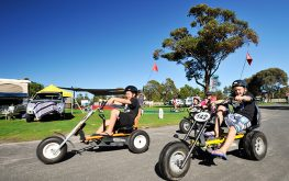 Kids riding on go karts in Lakes Entrance