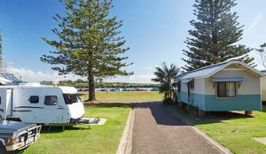 Caravan and cabin on a sunny day at NRMA Port Macquarie Breakwall Holiday Park