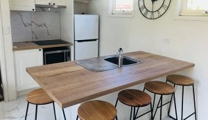 kitchen with bar stools inside a Bright holiday park