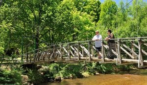 Couple looking at the water from a bridge in Bright