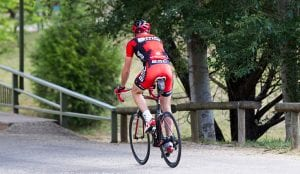 Man in red riding on a mountain bike in Bright