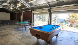 Games room in Bathurst showing a pool table with a blue top