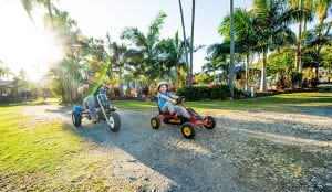 Kids riding a pedal go kart in Yeppoon.