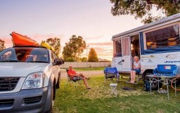 Older couple sitting on a caravan site at a Yarrawonga holiday park