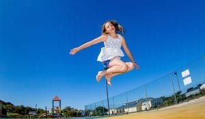Young girl jumping on the Bouncing Pillow
