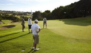 Men playing golf on a local course in Warrnambool
