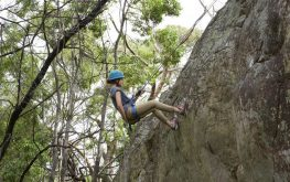 Young person abseiling down a cliff in Halls Gap