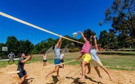 People playing volleyball inside a Halls Gap caravan park