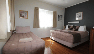 Atherton cottage bedroom with double bed and single bed