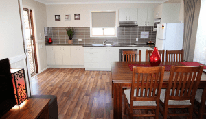 Atherton Kitchen and dining area with table and chairs