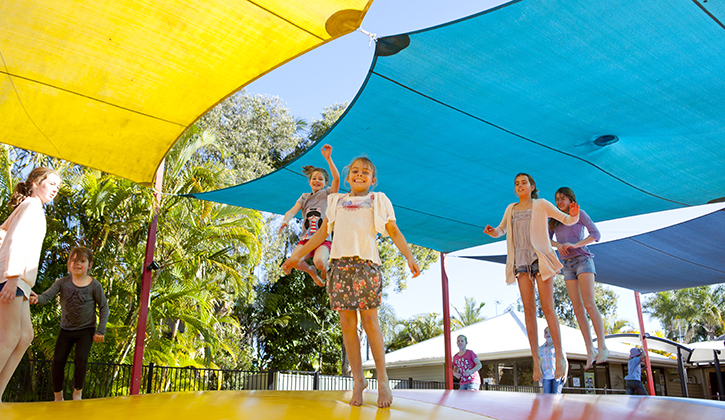 Kids jumping on a bouncing pillow at a Gold Coast Family Accommodation provider