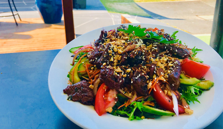 Beef salad on a white plate at a gold coast bristro